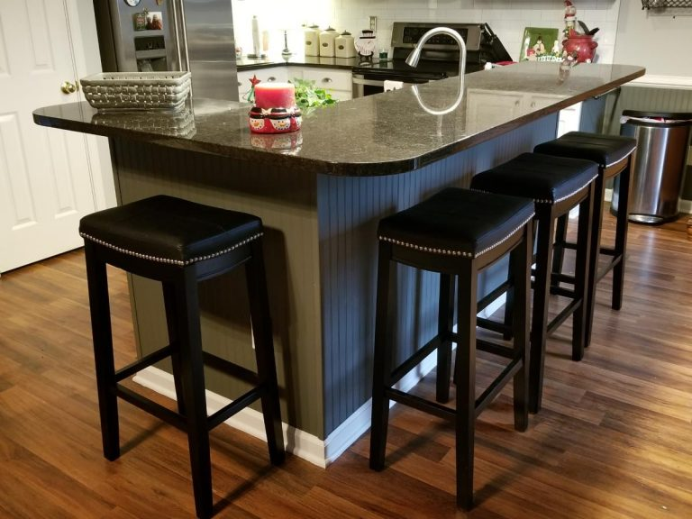 New refurbished kitchen with granite table and engineered hardwood flooring