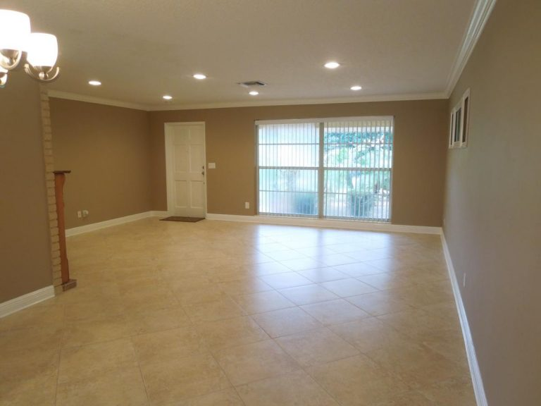 A remodeled living room installed with ceramic tile flooring