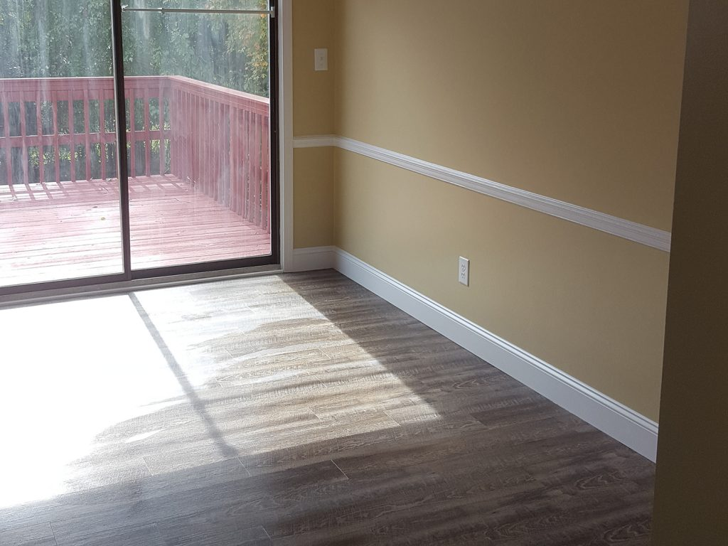 Renovated bedroom installed with engineered hardwood flooring in Greensboro