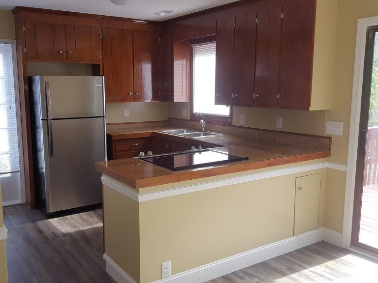 New upgraded kitchen with ceramic induction cooker installed in between the cabinet
