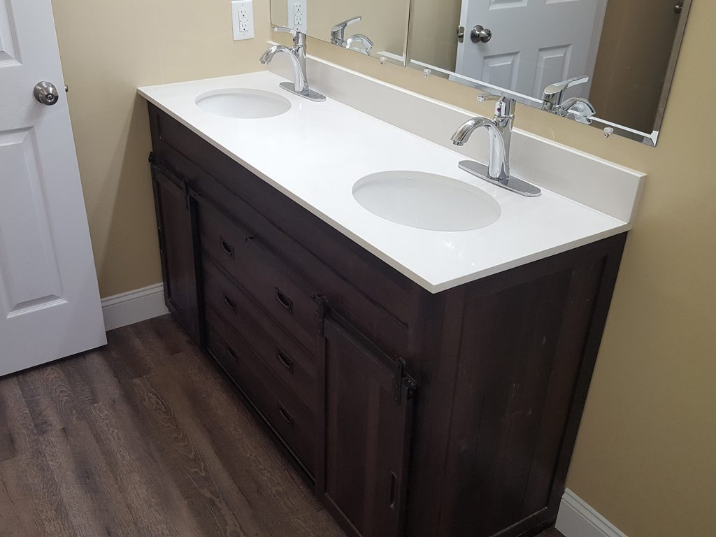 Renovated restroom installed with new double bathroom vanity