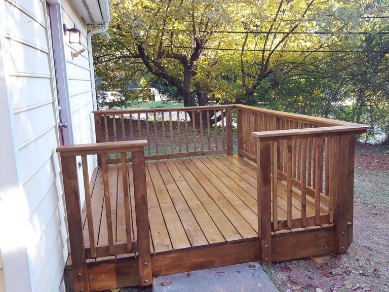 tiny wooden deck installed at the back door of the house