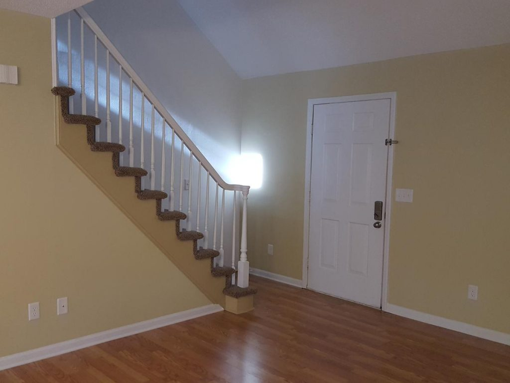 Newly painted sala and staircase trim