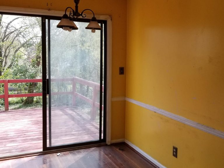 an living room view of a wooden deck before the renovation