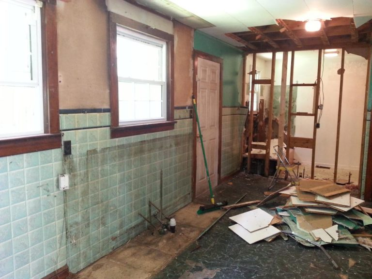 An overview of a damaged kitchen with dust and molds