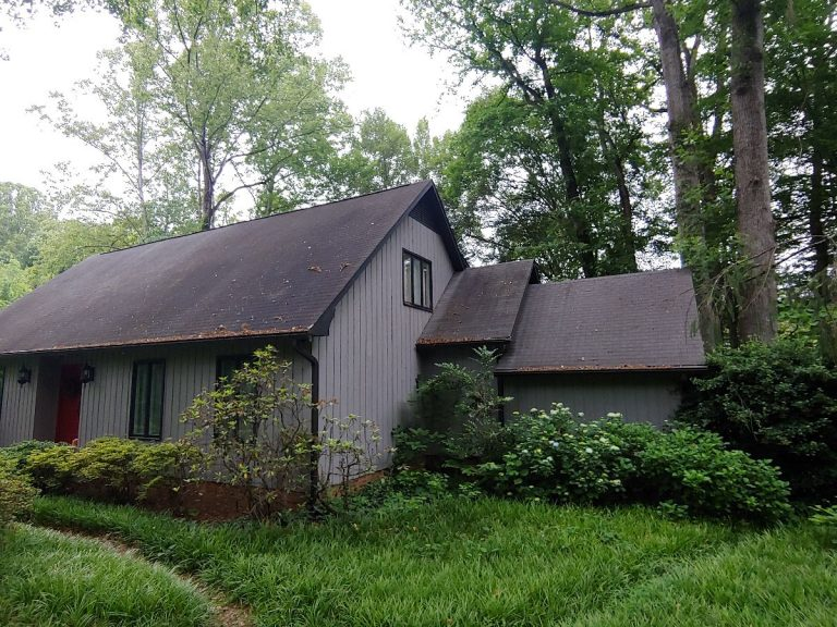 A house with dark brown shingles roofing