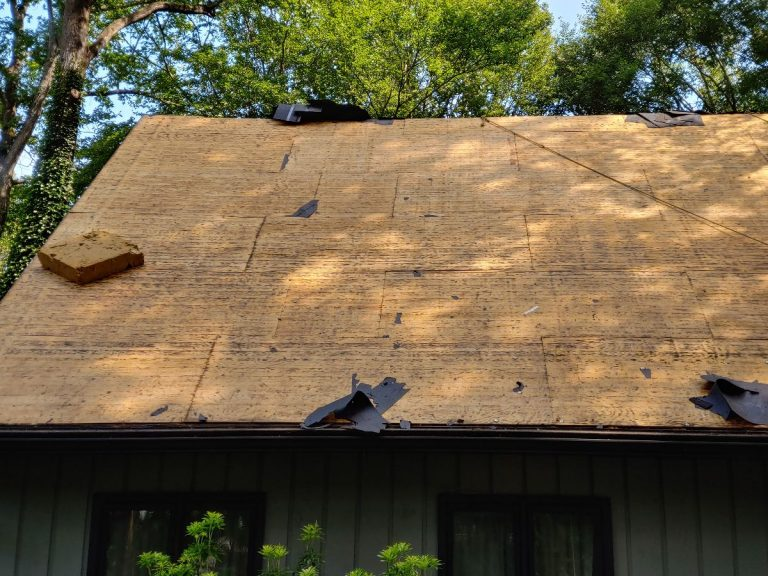 A roof which asphalt shingles have been removed for reroofing