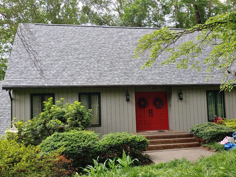 Front view of a residential house with asphalt shingle roofing installed