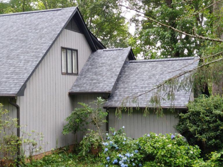 A house with gray fiberglass shingles