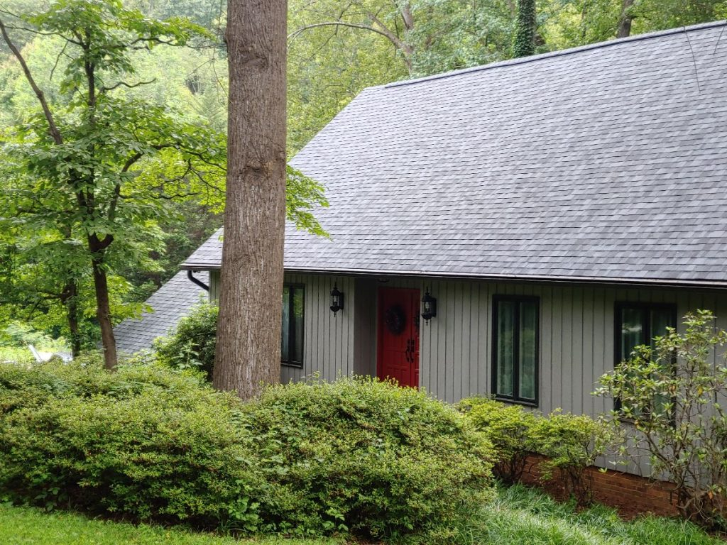 A House installed with an asphalt shingle roof