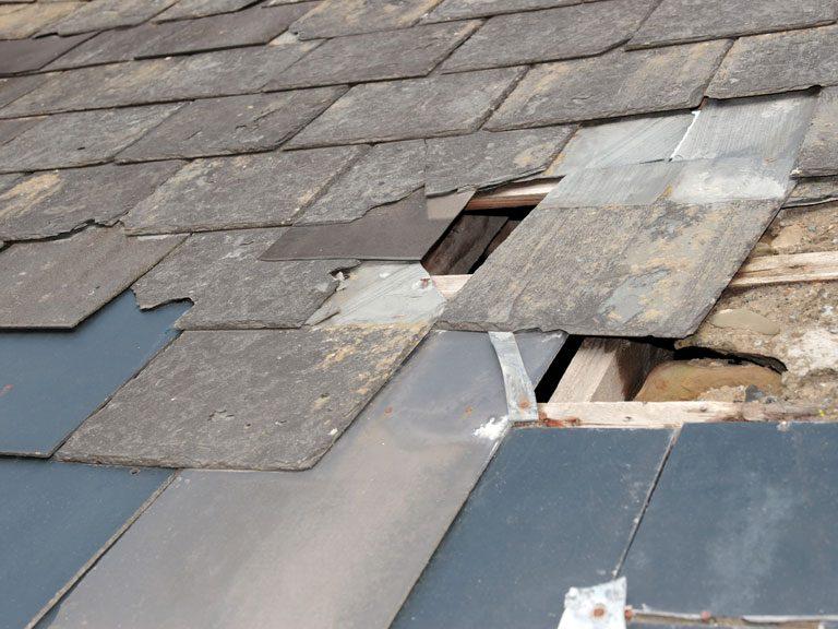 a shattered asphalt roof