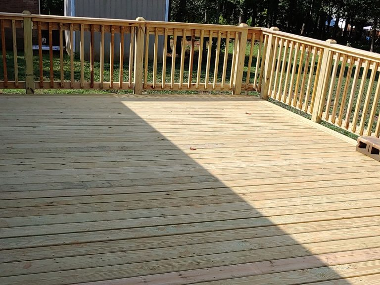 A deck made of wood before the paint