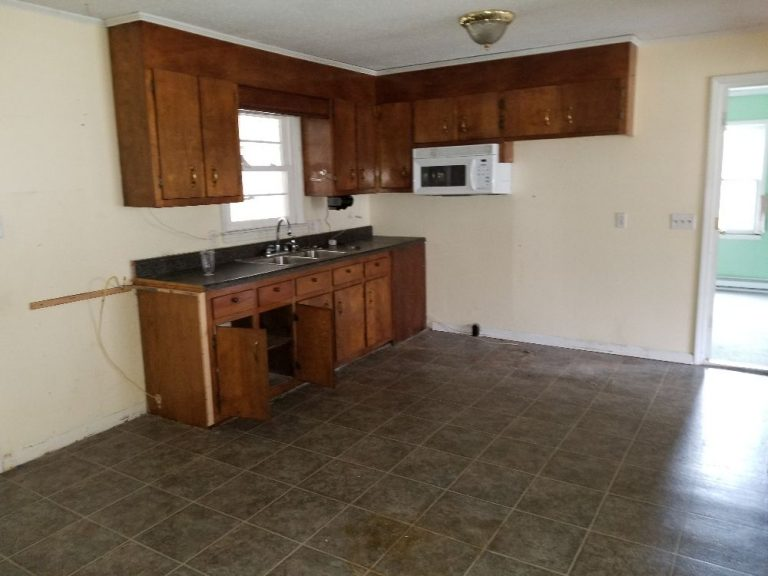 A kitchen of a house that has not been remodeled yet