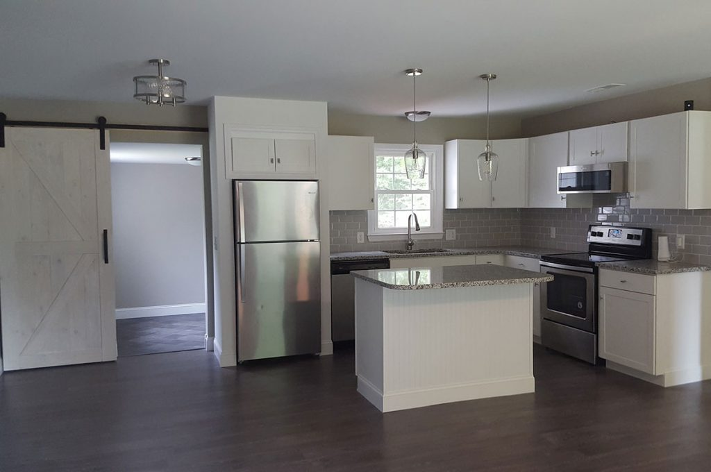 A newly refurbished kitchen equipped with granite countertops