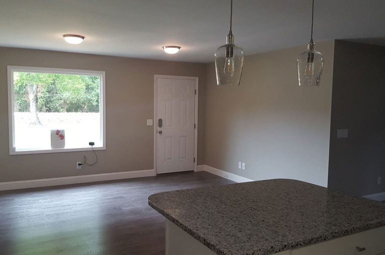 new renovated living room with granite tabletop and hardwood flooring in Triad NC
