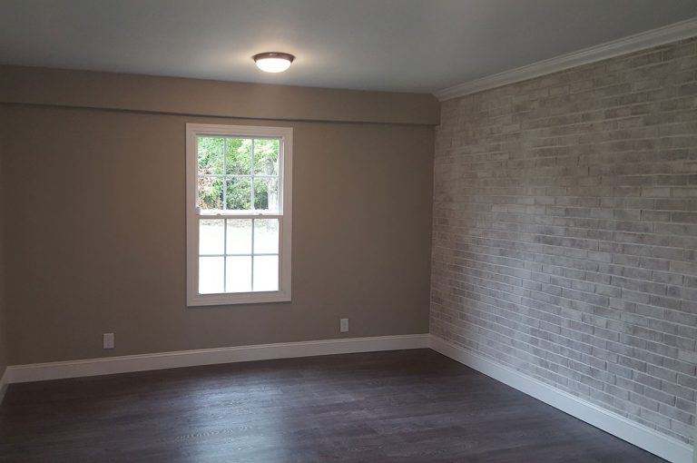 Renovated master bedroom painted with whitewash brick in Winston-Salem