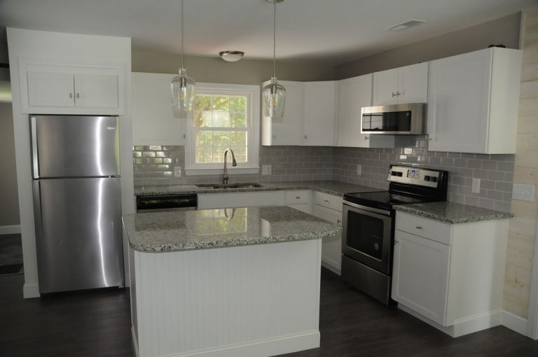 Freshly renovated kitchen installed with granite countertops