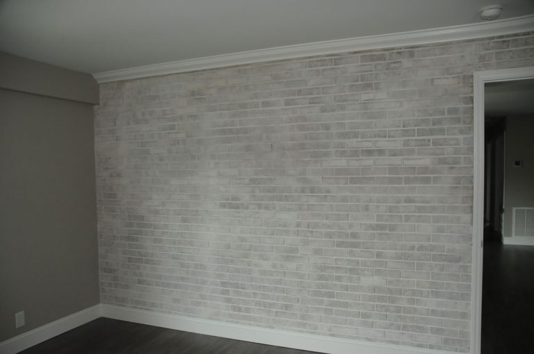 Renovated bedroom painted whitewash brick in High Point