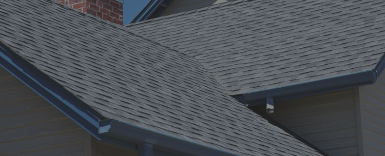 Freshly installed asphalt shingle roof on a house
