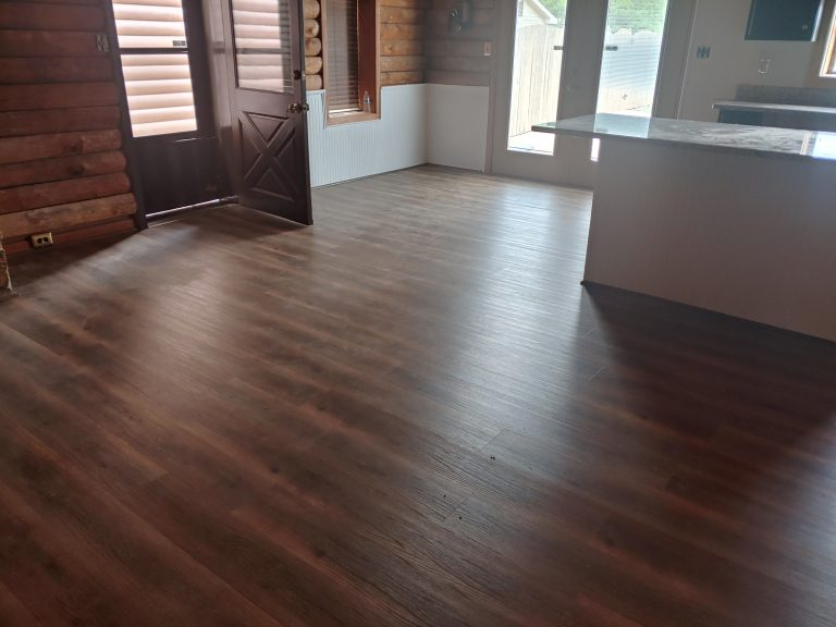 New kitchen and flooring in log cabin home